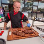 Chef Phillip Dell getting ready to cut into this beautiful grilled steak