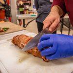 Cutting the Beautiful Bacon Wrapped Smoked Pork Tenderloin with Morello Cherry Sauce