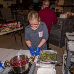 Tatem Helping Chef Phillip Dell at the Ultimate Holiday Grilling Class